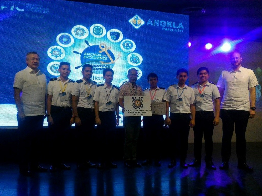 The champions, John B. Lacson Colleges Foundation (Bacolod), with Capt. Enrile and PHILCAMSAT Training Director Roy Akker.