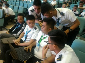 Participants from Mapúa-PTC College of Maritime Education and Training (CMET) of Malayan Colleges Laguna in a huddle to discuss their answers during the quiz bee.